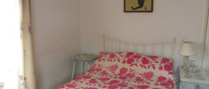Pink rose print cushion designed by caroline ede at rough acre in herefordshire