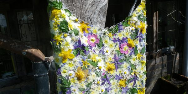 vest decorated with real flowers for summer flower clothes making project at rough acre wedding flowers workshops and thing of beauty in herefordshire